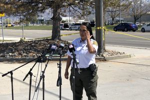 (Brian Maffly | The Salt Lake Tribune) Salt Lake County Sheriff Rosie Rivera speaks during a press conference about the shooting that injured two deputies outside the sheriff's South Salt Lake headquarters on Saturday, April 10, 2021. Investigators process the crime scene behind Rivera. The alleged shooter died in an exchange of gunfire with the injured officers.