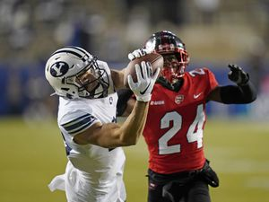 BYU wide receiver Gunner Romney, left, catches a pass next to Western Kentucky defensive back Roger Cray (24) during the first half of an NCAA college football game Saturday, Oct. 31, 2020, in Provo, Utah. (AP Photo/Rick Bowmer, Pool)