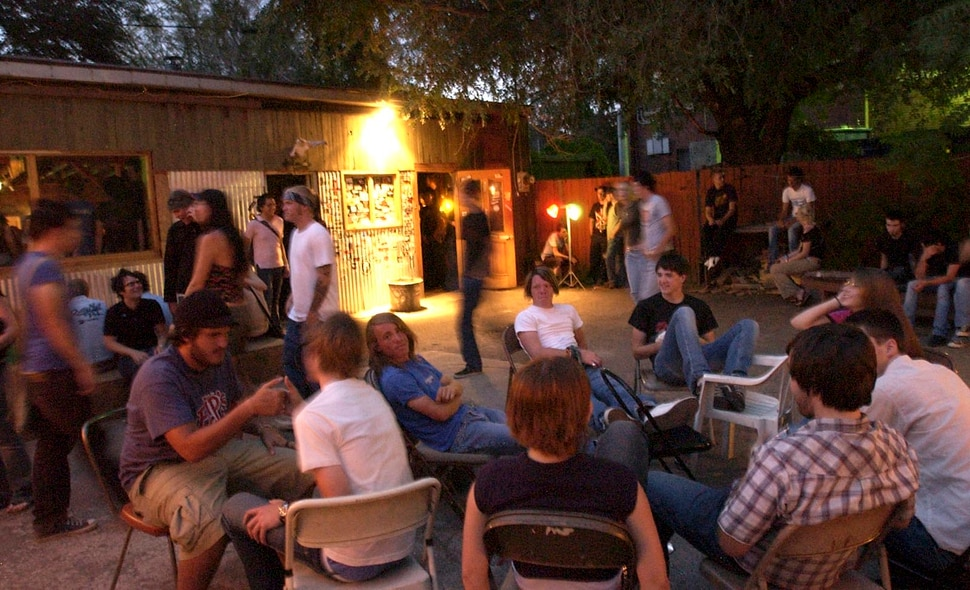 (Ryan Galbraith | Tribune file photo) Kids hang out in the open air at Kilby Court in 2004. The venue turns 20 this year.