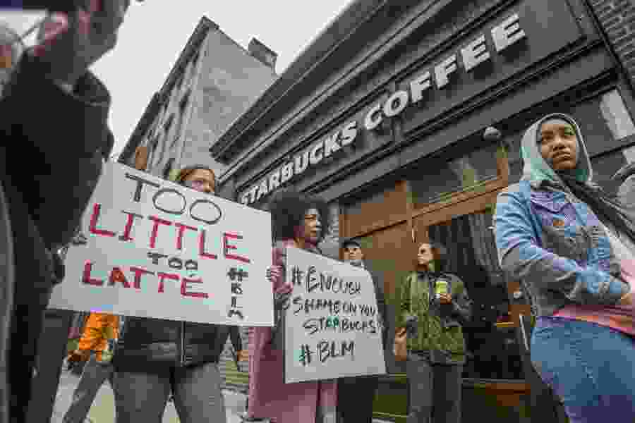 Two black men were arrested waiting at a Starbucks — now the company and police are on the defensive