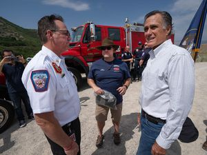 (Francisco Kjolseth | The Salt Lake Tribune) U.S. Sen. Mitt Romney looks up at the hillside homes near Draper as he is joined by Draper Fire Chief Clint Smith, left, and Draper Mayor Troy Walker after an announcement to establish a wildfire commission during a news conference at Little Valley Trailhead in Draper on Friday, June 18, 2021. The commission would conduct a national review of wildfire policy and make recommendations to Congress.