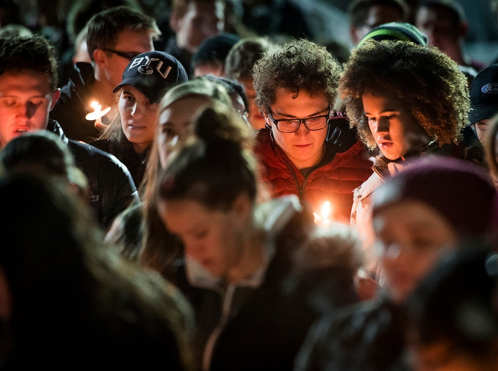 Michael Mangum   Special to the Tribune Issa McKnight, top right, and Adam Meadows, second from right, sing hymns with other students during a candlelight vigil held outside the N. Eldon Tanner Building on the campus of BYU in Provo, UT on Wednesday, December 5th, 2018.
