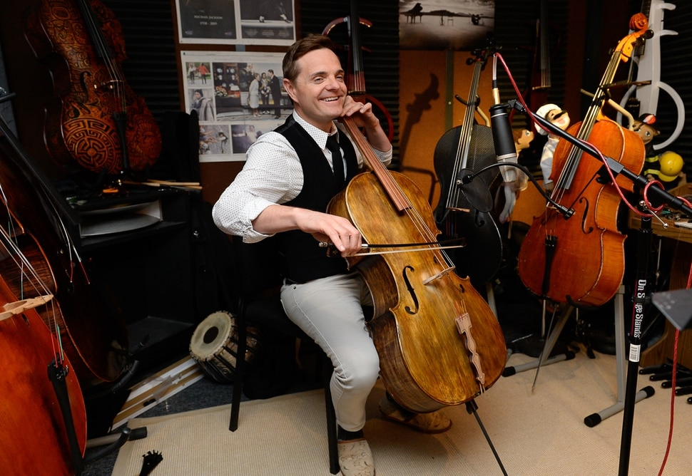 (Francisco Kjolseth | The Salt Lake Tribune) The Piano Guys cellist Steven Sharp Nelson plays one of his instruments in the sound booth of the band's home studio in Sandy.