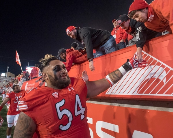 Rick Egan | The Salt Lake Tribune Utah Utes offensive lineman Isaac Asiata (54) high-fives fans after the Utes, 36-23 win over Arizona, in PAC-12 football action, at Rice-Eccles Stadium, Saturday, October 8, 2016.