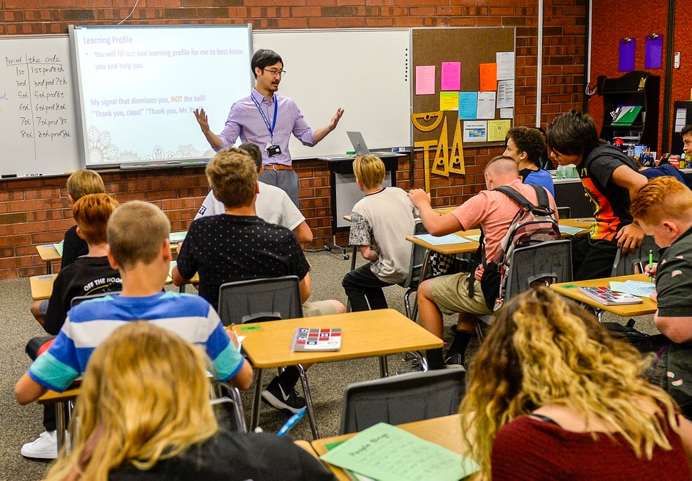 (Leah Hogsten | The Salt Lake Tribune) Pinyi Yao, 27, a Chinese National teaching 7th and 8th grade math welcomes his students on their first day of the school year at Oquirrh Hills Middle School, August 20, 2019 in Riverton.