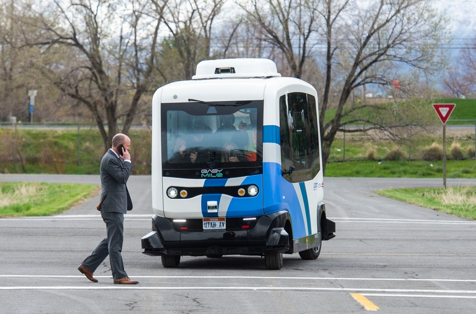 (Rick Egan | The Salt Lake Tribune) Lt. Governor Spencer J. Cox walks in front of an Autonomous Shuttle, to see if it will stop for him, during a demonstration as the Utah Department of Transportation, in partnership with the Utah Transit Authority, launched a new Autonomous Shuttle Pilot Project at the test track is across the street from UDOT headquarters on the west side of 2700 West. Thursday, April 11, 2019.