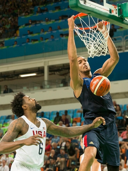 (Rick Egan | The Salt Lake Tribune) Rudy Gobert (16) of France dunks the ball, as DeAndre Jordan (6) of United States looks on, in Olympic basketball action, USA vs. France, in Rio de Janeiro Brazil, Sunday, August 14, 2016.