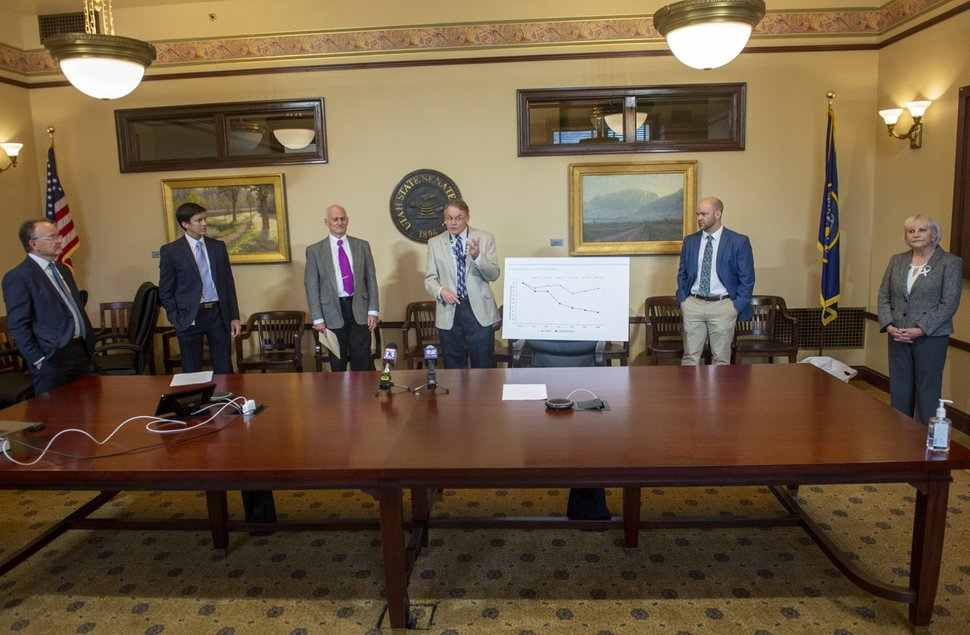 (Rick Egan | Tribune file photo) Family physician Dr. Marc C. Babitz, center, says a few words as elected officials, from left, Utah Senate President Stuart Adams, Sen. Kirk Cullimore, Dr. Kurt Hegmann, director of Rocky Mountain Center for Occupational and Environmental Health at the University of Utah, Dan Richards, CEO, pharmacist of Meds In Motion Pharmacy, and Sen. Karen Mayne, keep their distance from each other as they talk about how they are teaming up to fight the coronavirus, in a news conference at the Utah State Capitol, Friday, March 20, 2020.