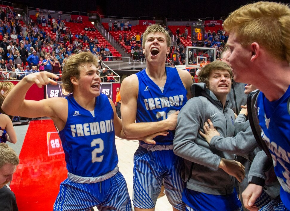 (Rick Egan | The Salt Lake Tribune) The Fremont Silverwolves Talmage Mitchell (2) and Dallin Hall (30) celebrate their 55-52 win over the Davis Darts, in the 6A basketball championship game at the Jon M. Huntsman Center, Saturday Feb. 29, 2020