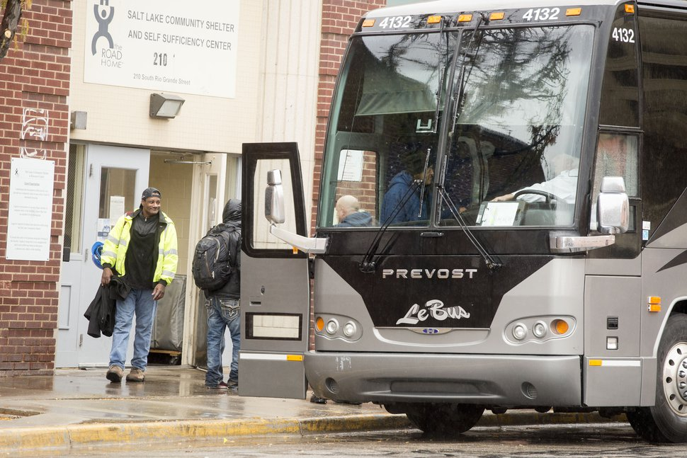 (Jeremy Harmon | The Salt Lake Tribune) People board a bus outside the Road Home as they move to the new men's resource center on 3300 South on Wednesday, Nov. 20, 2019. The Road Home will be closed soon.