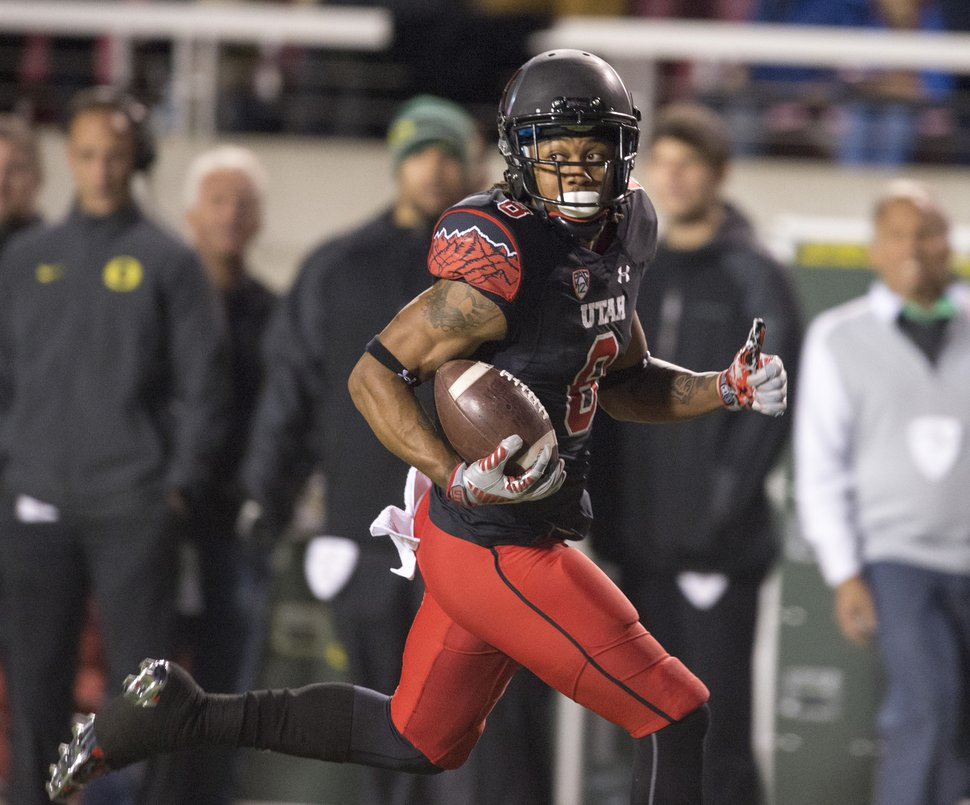 Utah Utes wide receiver Kaelin Clay (8) runs for the end zone on a long pass play, but dropped the ball before he reached the end zone, resulting in an a 99-yard Oregon touchdown, in PAC-12 action, Utah vs. Oregon game, at Rice-Eccles Stadium, Saturday, Nov. 8, 2014. (AP Photo/The Salt Lake Tribune, Rick Egan)