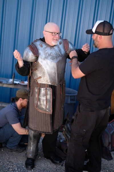 """(Photo courtesy Doug Pasko) It takes a team to get Salt Lake Tribune TV critic Scott D. Pierce into a suit of armor on the set of """"The Outpost."""""""