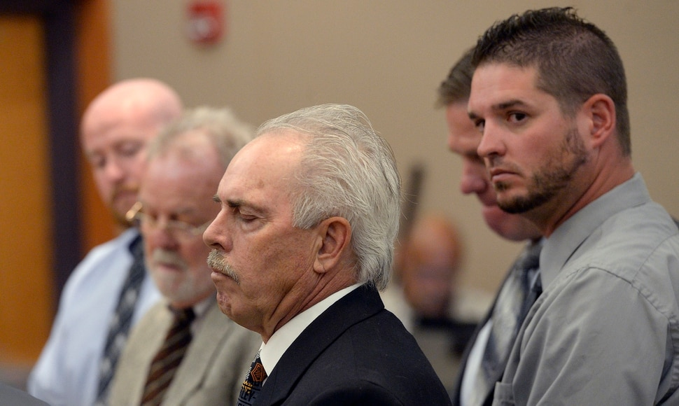 (Al Hartmann | Tribune file photo) Former Daggett County Sheriff Jerry Jorgensen, front left, talks with lawyers and former jail commander Lt. Benjamin Lail, right, in Third District Court in Park City on July 17, 2017 before Judge Kent Holmberg on charges connected to the abuse of jail inmates at the Daggett County jail. A third person charged at far left is Deputy Joshua Cox.