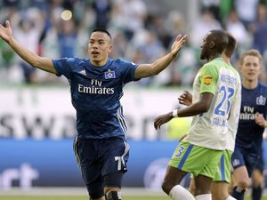 FILE - In this Saturday, April 28, 2018 file photo, Hamburg's Bobby Wood celebrates after scoring during their German Bundesliga soccer match against VfL Wolfsburg in Wolfsburg, Germany. (AP Photo/Michael Sohn, file)