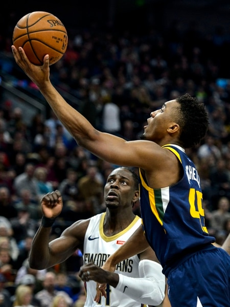(Steve Griffin | The Salt Lake Tribune) Utah Jazz guard Donovan Mitchell (45) scoops up a shot during the the Utah Jazz versus the New Orleans Pelicans NBA basketball game at the Vivint Smart Home Arena in Salt Lake City Wednesday January 3, 2018.