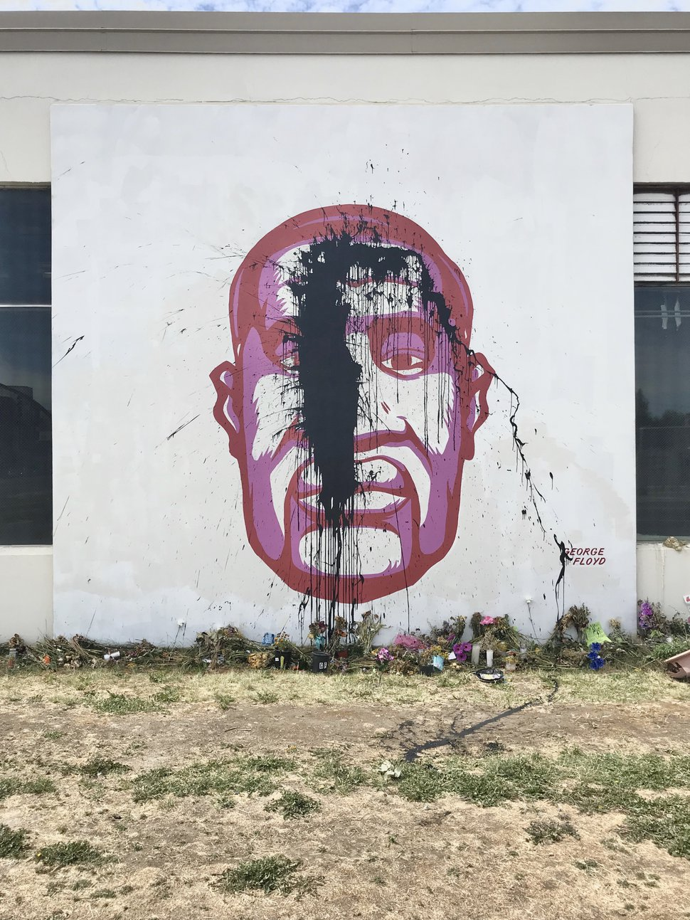 (Courtesy photo) A tar-like substance was used to deface a mural on a building near 300 West and 800 South in Salt Lake City that depicts George Floyd. Artists later returned to fix the vandalism on Sunday, June 21, 2020.