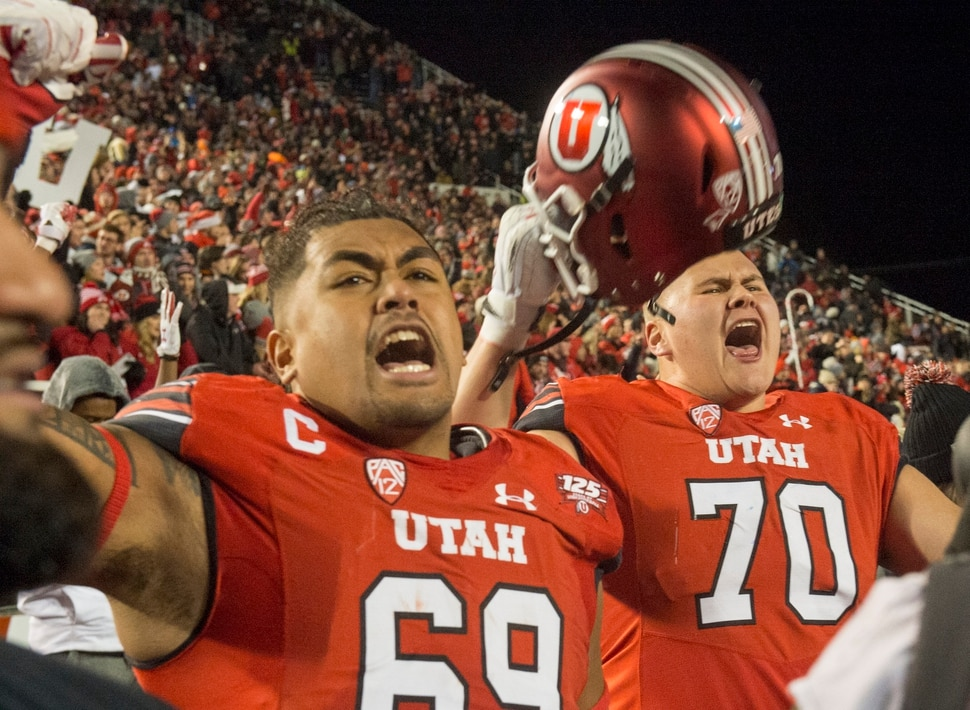 (Rick Egan | The Salt Lake Tribune) Utah Utes offensive lineman Lo Falemaka (69) and offensive lineman Jackson Barton (70) celebrate as the Utes stop the Cougars on 4th down wth just seconds left in the game, giving Utah the victory, in football action between the Brigham Young Cougars and the Utah Utes, at Rice-Eccles Stadium, Saturday, November 24, 2018.
