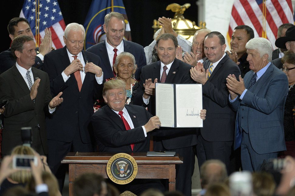 (Francisco Kjolseth | Tribune file photo) President Donald Trump is surrounded by Utah representatives at the Utah Capitol on Monday, Dec. 4, 2017, after signing two presidential proclamations to shrink Bears Ears and Grand Staircase-Escalante national monuments.