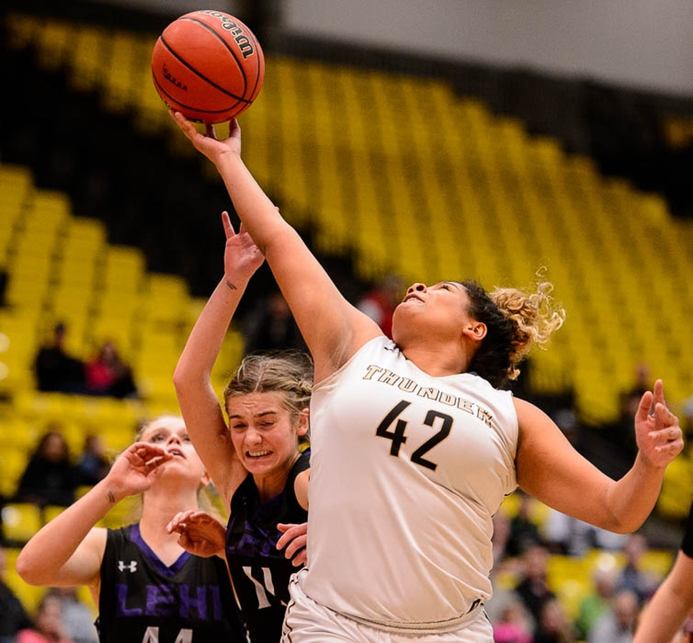 (Trent Nelson | The Salt Lake Tribune) Lehi vs. Desert Hills, 4A State high school basketball tournament at Utah Valley University in Orem, Thursday March 1, 2018. Desert Hills's Jessica Bills (42) pulls in a rebound over Lehi's Samantha Lewis (11).