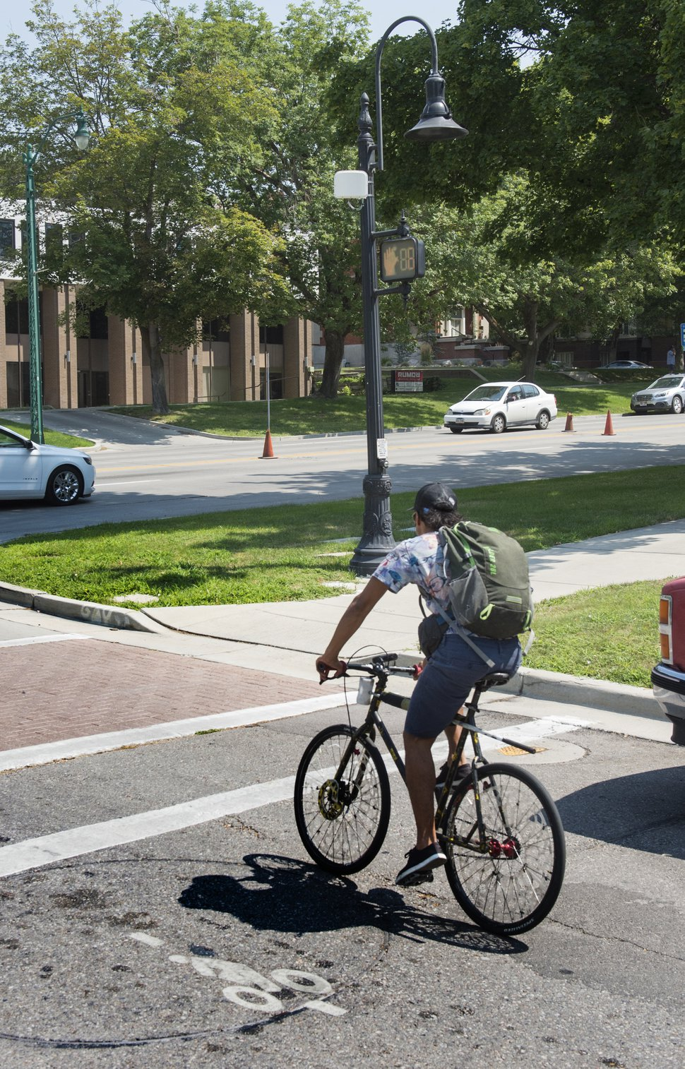(Rick Egan | The Salt Lake Tribune) Salt Lake City has installed ten traffic signal detectors, which use a radar device that is triggered by people riding bicycles, to help bicyclists cross the street when no traffic is around. Wednesday, Aug. 1, 2018.