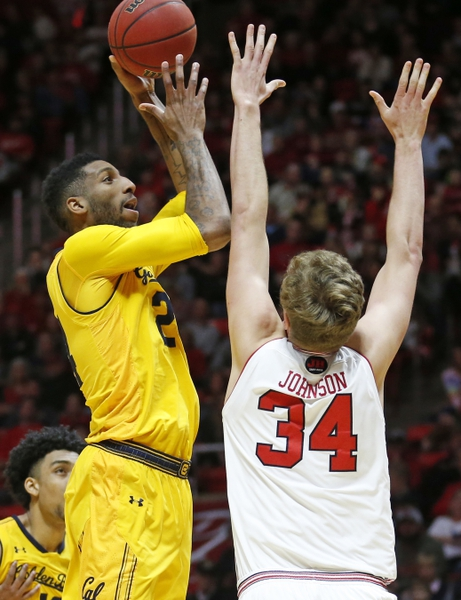 California forward Marcus Lee (24) shoots as Utah forward Jayce Johnson (34) defends during the first half during an NCAA college basketball game Saturday, Feb. 10, 2018, in Salt Lake City. (AP Photo/Rick Bowmer)