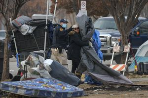 (Leah Hogsten  |  The Salt Lake Tribune) Tensions flared between protesters and police in downtown Salt Lake City on Thursday, Dec. 10, 2020 as dozens of people experiencing homelessness were forced to leave the camps where they were living.