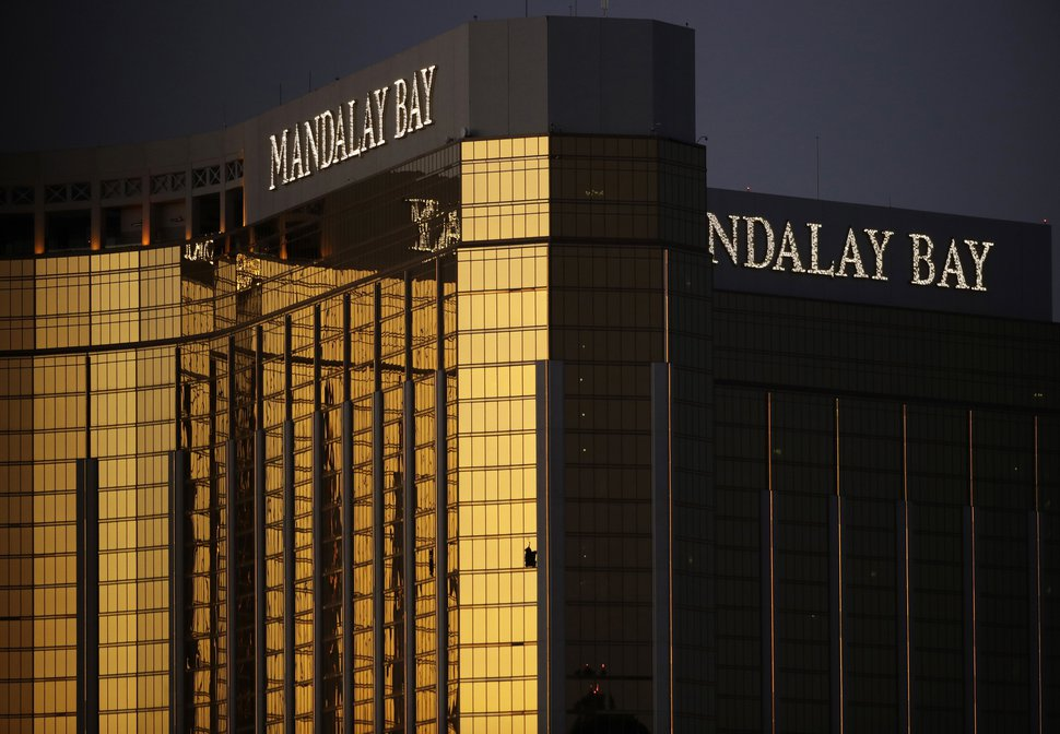 FILE - In this Oct. 3, 2017, file photo, windows are broken at the Mandalay Bay resort and casino in Las Vegas, the room from where Stephen Craig Paddock fired on a nearby music festival, killed 58 and injuring hundreds on Oct. 1. Attorneys for a group of victims of the Las Vegas mass shooting harshly criticized MGM Resorts International this week over its legal maneuver seeking to consolidate multiple lawsuits stemming from the massacre. The victims' attorneys in court documents filed Tuesday, Aug. 14, 2018, say the casino operator is acting with improper motives in seeking to have the cases combined in one court. (AP Photo/John Locher, File)