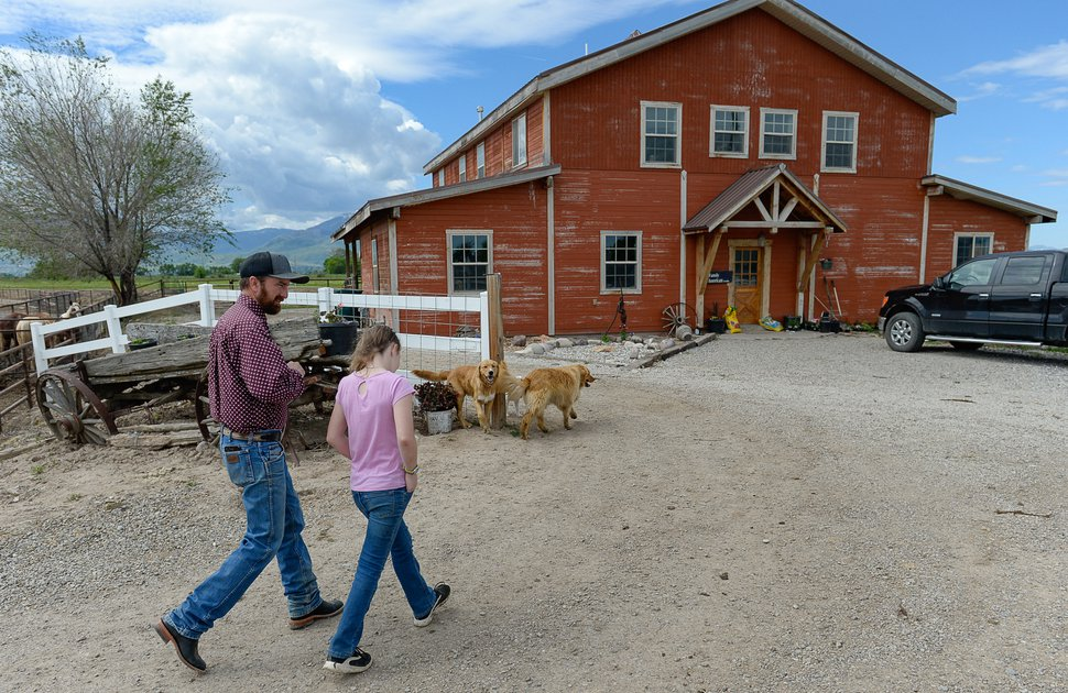 (Francisco Kjolseth   The Salt Lake Tribune) Utah County Commissioner Nathan Ivie spends time with his daughter McKylie, 11, on his horse ranch in Benjamin, Utah. The Republican lawmaker in a heavily-Mormon area of Utah has publicly come out as gay. Ivie said his announcement, Wednesday, May 22, 2019, was inspired in part by his work with families who have lost gay children to suicide.