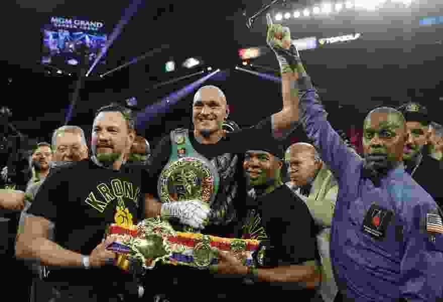 Fury wins in stunning stoppage of Wilder in heavyweight tilt