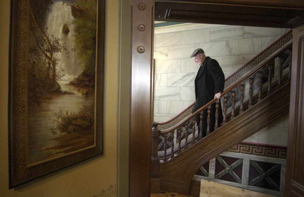 Francisco Kjolseth | The Salt Lake Tribune Catholic Bishop George H. Niederauer who is celebrating his 10th anniversary as the bishop of Utah this month walks down the stairs of the office of the Intermountain Catholic Newspaper located next door to the Catholic Pastoral Office in Salt Lake City on January 7, 2005.