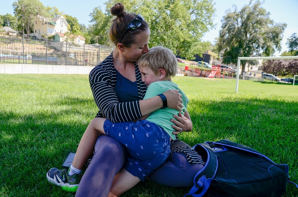 (Francisco Kjolseth | The Salt Lake Tribune) Lana Medina gets a warm embrace from her son Dylan, 5, following his first day of kindergarten at Washington Elementary on Monday, Aug. 19, 2019.