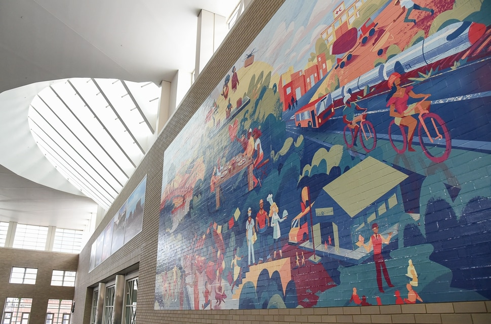 (Francisco Kjolseth | The Salt Lake Tribune) Salt Lake City Mayor Jackie Biskupski and Salt Lake County Mayor Jenny Wilson help reveal and dedicate a new legacy mural on Monday, Dec. 30, 2019, placed at the Salt Palace to commemorate the 68thÊUnited Nations Civil Society Conference which took place in Salt Lake City in August. The mural was created by Tooele based Digital Gravy which specializes in 2D design-based animation.