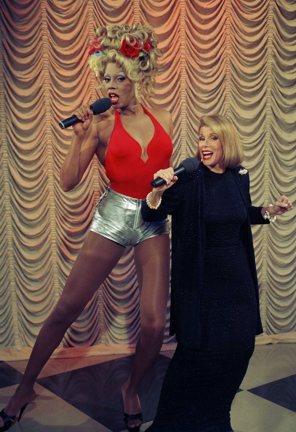 Entertainer RuPaul, left, sings a number from his debut album