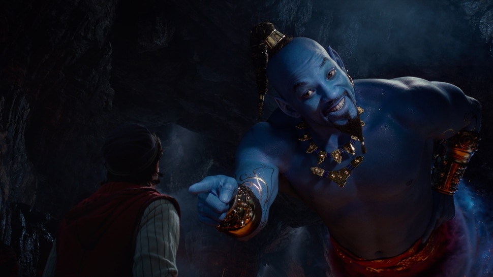 (Image courtesy Walt Disney Pictures) Aladdin (Mena Massoud, left) meets the larger-than-life blue Genie (Will Smith) in Disney's live-action adaptation Aladdin, directed by Guy Ritchie.