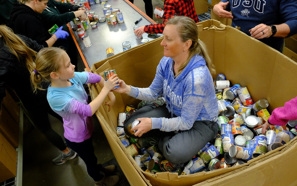 (Francisco Kjolseth   The Salt Lake Tribune) Tiffany Vaughn and her daughter Emily, 6, of Park City help out at The Utah Food Bank on Saturday, March 14, 2020, after hearing they are hurting for volunteers, since groups that normally volunteer canceled after the order of mass gatherings due to the coronavirus outbreak.
