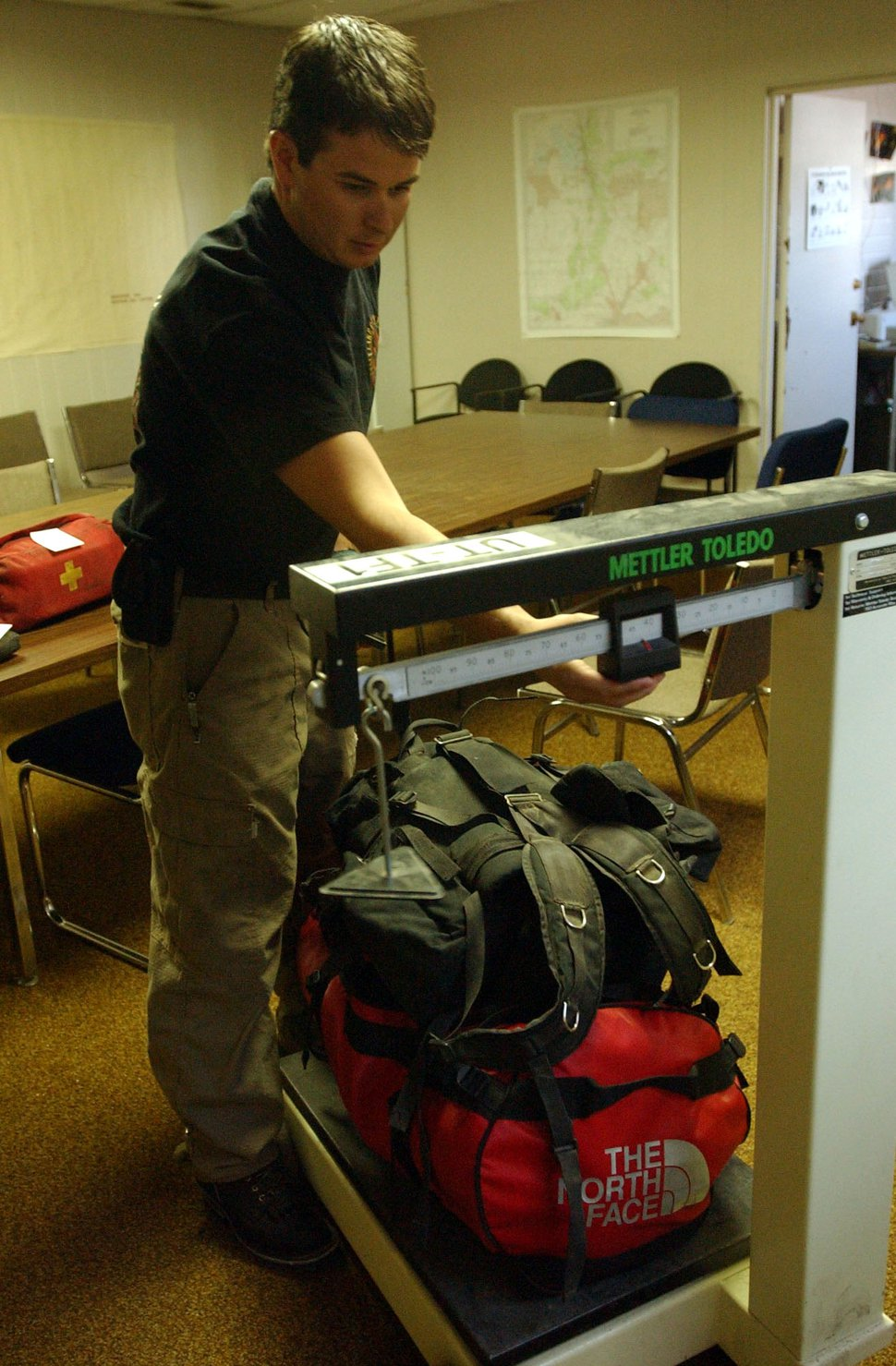 (Danny La | Tribune file photo) In this 2003 file photo, crew boss Matt Burchett weighs his equipment as Utah firefighters prepare to go to Texas to assist in the search for debris from the Space Shuttle Columbia. Burchett died on Aug. 13, 2018, while fighting wildfires in California.