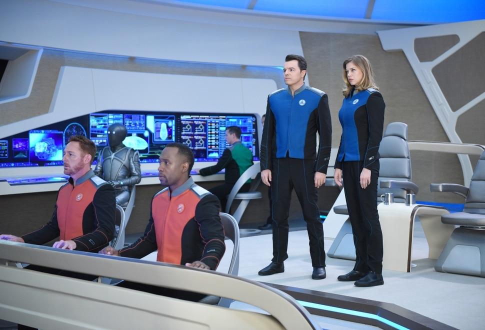 "(Michael Becker/Fox) Scott Grimes, Mark Jackson, J Lee, Seth MacFarlane and Adrianne Palicki on the ship's bridge in ""The Orville."""