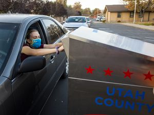 (Rick Egan | Salt Lake Tribune file photo) A voter drops off her ballot at the drop-off location in Lehi, on Tuesday, Nov. 3, 2020. A number of Utah cities, including Salt Lake City and Lehi, will be using ranked-choice voting this year.