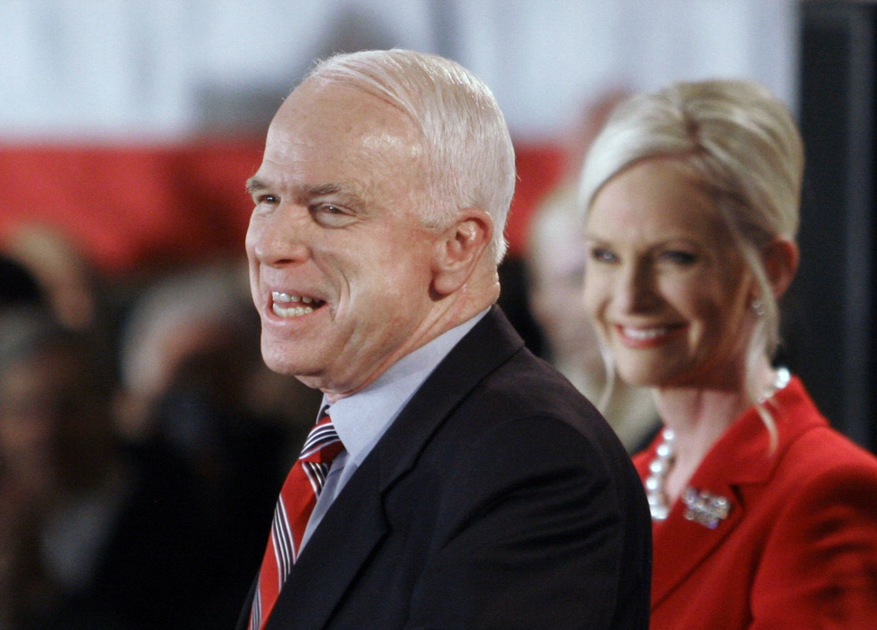 FILE - In this Jan. 8, 2008 file photo, Republican presidential hopeful Sen. John McCain, R-Ariz., with wife Cindy alongside, addresses supporters on election night in Nashua, N.H. McCain's family says the Arizona senator has chosen to discontinue medical treatment for brain cancer. (AP Photo/Bill Sikes)