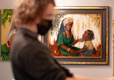 "(Francisco Kjolseth | The Salt Lake Tribune) Malachi Wilson, curatorial assistant at Writ & Vision bookstore and fine art store, hangs a new exhibit titled ""Visions of Heavenly Mother"" in gallery space along Center Street in Provo on Tuesday, May 4, 2021."