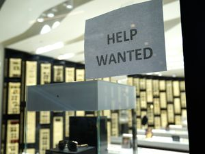 (Lynne Sladky | AP file photo) A Help Wanted sign is posted at a Designer Eyes store at Brickell City Centre, Friday, Nov. 6, 2020, in Miami. The number of people applying for unemployment aid jumped last week to 853,000, the most since September, evidence that some companies are cutting more jobs as new virus cases spiral higher. The Labor Department said Thursday, Dec. 10, that the number of applications increased from 716,000 the previous week.