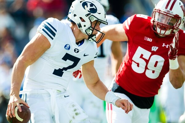 (Chris Detrick | The Salt Lake Tribune) Brigham Young Cougars quarterback Beau Hoge (7) is chased down for a safety by Wisconsin Badgers linebacker Tyler Johnson (59) during the game at LaVell Edwards Stadium Saturday Saturday, September 16, 2017. Wisconsin Badgers defeated Brigham Young Cougars 40-6.