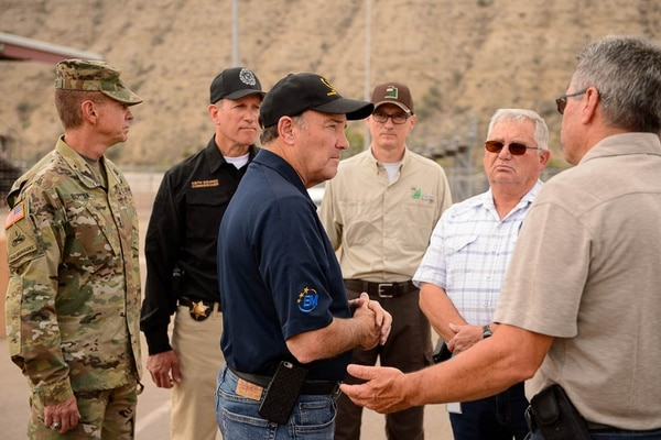 (Trent Nelson | The Salt Lake Tribune) Utah Governor Gary Herbert confers with state and local officials at the incident base for the Dollar Ridge Fire in Duchesne, Tuesday July 3, 2018.