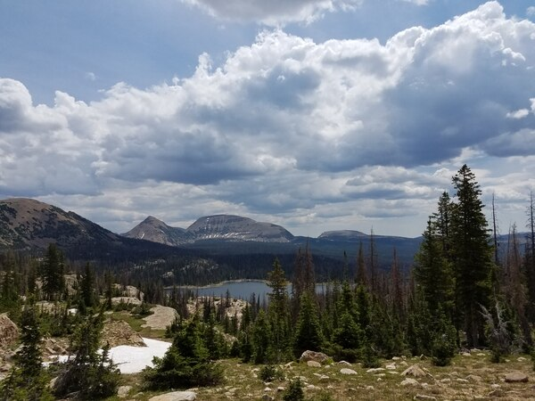Jessica Miller | The Salt Lake Tribune A lake is spotted in the distance during a hike to Clyde Lake in the Uinta Mountains.