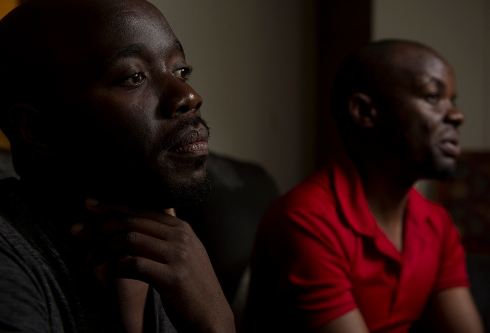 (Leah Hogsten | The Salt Lake Tribune) l-r In their native Uganda, a place where being gay can send you to prison, Barnabas Wobiliya and Appollo Kimuli risked their lives as advocates for AIDS education and equality for the LGBTQ community. Threatened with death, both men fled and spent a year in refugee camps before resettlement in Utah. The two are now trying to build their lives here, while using the Internet to continue their activism for others in Africa's LGBTQ community.