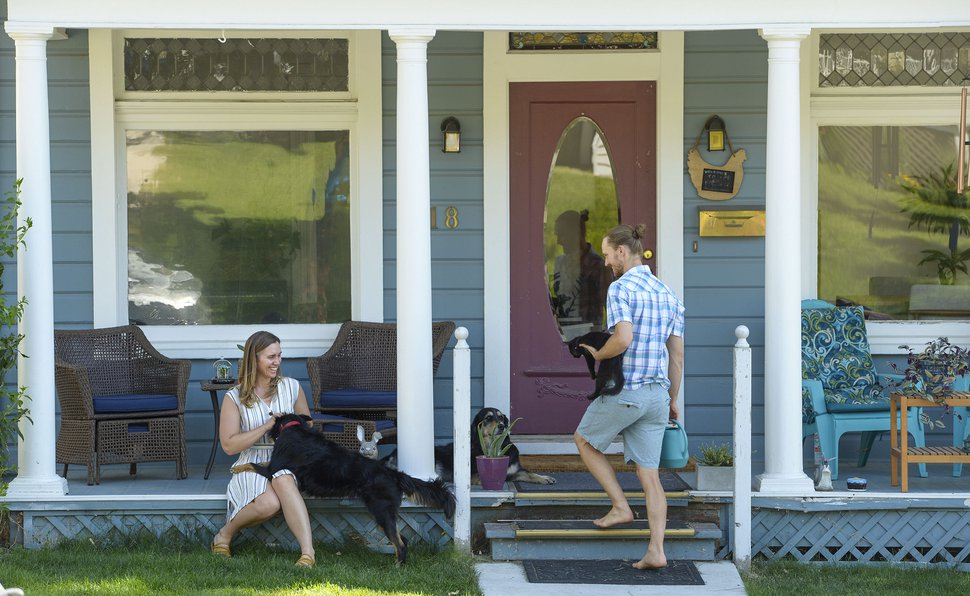 (Leah Hogsten | The Salt Lake Tribune) Dr. Jackie Simonis, left, and her husband, Dean Tanner, right, with their animals at home in the Avenues, Aug. 1, 2020. The couple spend two weeks of every month on the Hopi and Navajo nations as emergency room doctors. Simonis, who contracted COVID-19 in May, suffered mild symptoms and despite living in a small apartment on the reservation, did not give the virus to her husband. Tanner has tested negative multiple times for the virus and its antibodies.