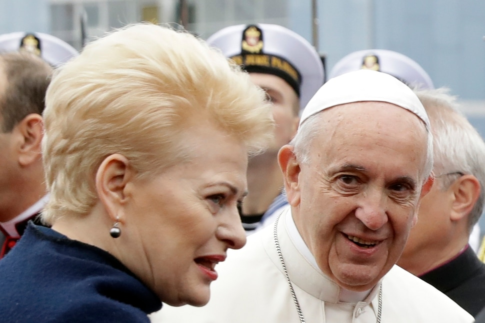 (Andrew Medichini | AP Photo) Pope Francis is welcomed by Lithuanian President Dalia Grybauskaite as he arrives at Vilnius airport, Lithuania, Saturday, Sept. 22, 2018. Pope Francis begins a four-day visit to the Baltics amid renewed alarm about Moscow's intentions in the region it has twice occupied.