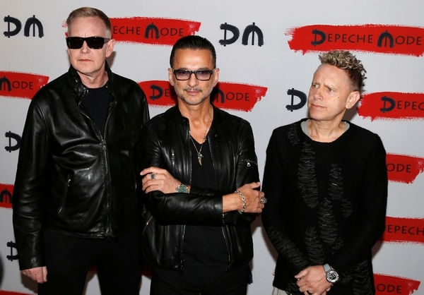 From left, Andrew Fletcher, Dave Gahan and Martin Gore, of the British band Depeche Mode, pose for photographers prior to the start of a press conference to promote their upcoming tour and new album in Milan, Italy, Tuesday, Oct. 11, 2016. (AP Photo/Antonio Calanni)