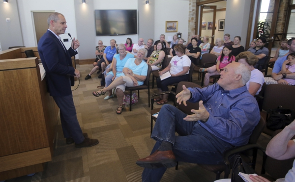 (Rick Bowmer | Associated Press file photo) In this Saturday, June 23, 2018, photo, Rep. John Curtis speaks during a town hall meeting in Cottonwood Heights.