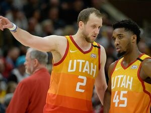 "(Francisco Kjolseth  |  Tribune file photo) Joe Ingles calls his shot, pointing to the spot where he plans to launch a home run off of Utah Jazz teammate Donovan Mitchell when they finally go through with their baseball challenge. Ingles intends to celebrate by running ""around the triangle thing with my shirt off."""